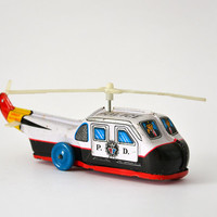 Vintage Police helicopter tin toy