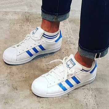 adidas superstar womens blue stripe