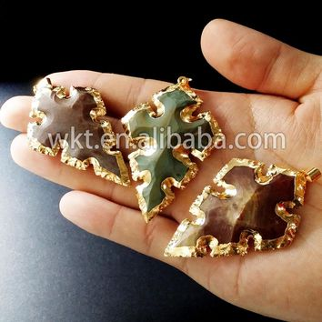 Natural carved stone at gate arrowhead pendants with 24k gold trim on edged