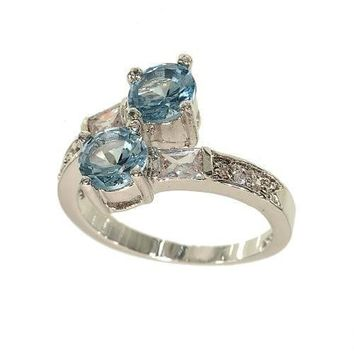 Delicate Looking Crossover Silvertone Fashion Ring in Pale Blue Aqua Spinel and Cubic Zirconia