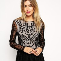 ASOS Crop Top with Long Sleeves and Embroidery at asos.com