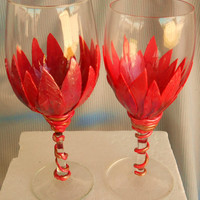 Custom decorated wine glasses for weddings ,anniversarys,or any special event.You can choose your color' s and any writing you desir.e
