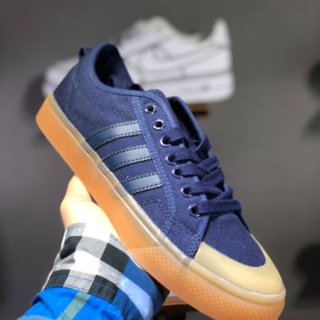 hcxx A1484 Adidas Nizza Blanc Bordeaux LO Campus canvas sneakers with half-cut rubber-covered toe Blue Brown