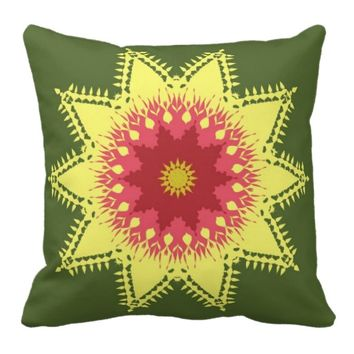 Artistic mandala on green pillows