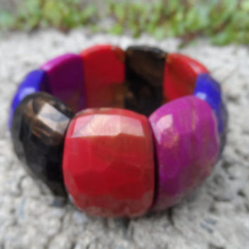 Vintage ladies Bakelite bracelet bangle with multicoloured faced segments on elastic - Rare Bakelite early plastic costume jewellery