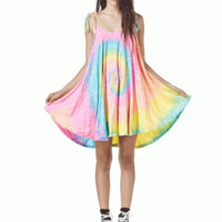 Create an unstoppable appearance with the Pusher Tie Dye Flare Dress by Unif Clothing. Featuring super soft blended fabrication, a round neckline with a flowy babydoll fit, super sweet sorbet-like tie dye throughout, string tie shoulder straps, flare skirt