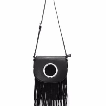 This cool style bag features textured vegan leather, big grommet accents on front flap with long fringe under, and top zipper closure. Interior features pockets and full lining and finish with back zip pocket. Bag is finished with adjustable shoulder strap
