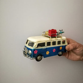 Retro VW van, hippie van in royal blue and creamy white with painted flowers and suitcases on the baggage rack, VW collectible miniature