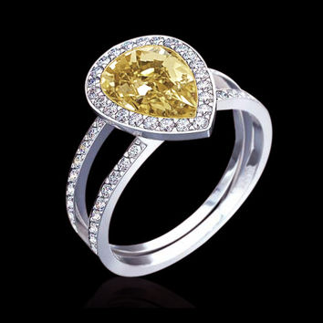 4 ct. fancy yellow pear cut diamonds engagement ring