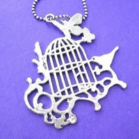 Bird Cage Silhouette Pendant with Birds Butterflies and Floral Detail in Silver