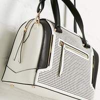 DailyLook: Issa Rae Perforated Vegan Leather Satchel in White