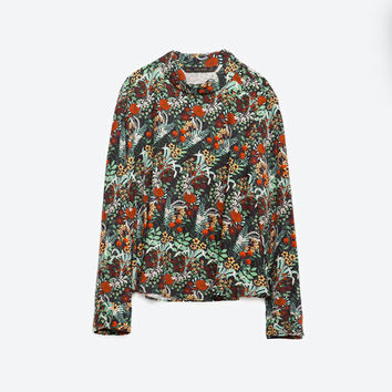 PRINTED ROLL NECK BLOUSE
