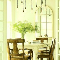 beautiful french dining room with lightbulbs
