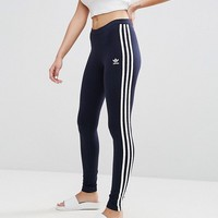 adidas Originals Three Stripe Legging In Navy at asos.com