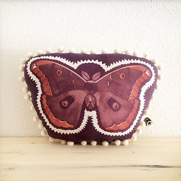 Polyphemus moth pillow decorative plush printed with inkodye on linen in plum, sepia, copper with natural linen back and cream pom pom trim