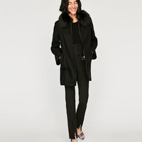 COAT WITH BELL SLEEVES DETAILS