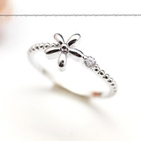 Dainty 5 petal flower ring detailed with CZ