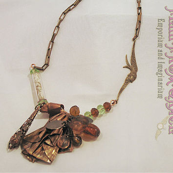 Inspired by steampunk  necklace - fold formed copper pendant with secret message tube and swallow