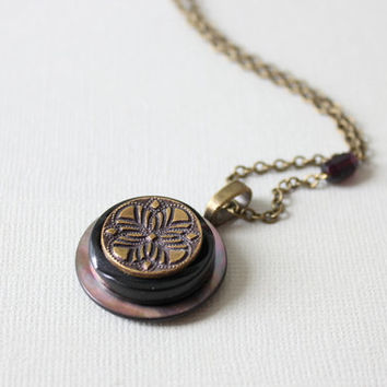 Vintage button necklace.  Purple and brass necklace made with vintage and antique buttons