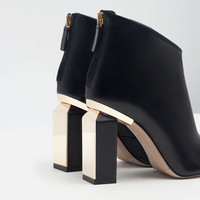 LEATHER AND METAL HEELED BOOTIES