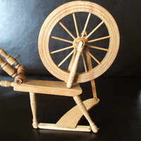 Vintage miniature handmade spinning wheel .