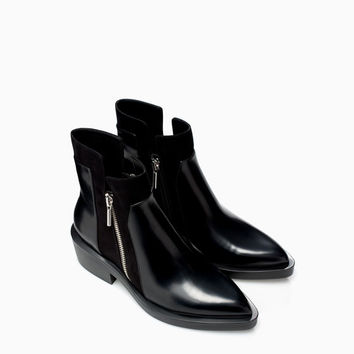 FLAT ANKLE BOOT WITH ZIP