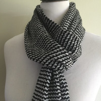 Handwoven chenille black and gray scarf.