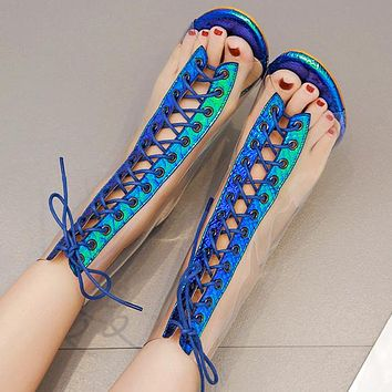 Fashionable transparent sandals cross laced high heels
