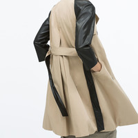 Raincoat with contrast sleeve