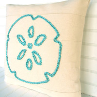 Turquoise sand dollar design pillow for your coastal living beach house