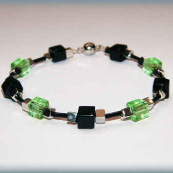Pale Green and Black glass bead bracelet with a magnetic clasp