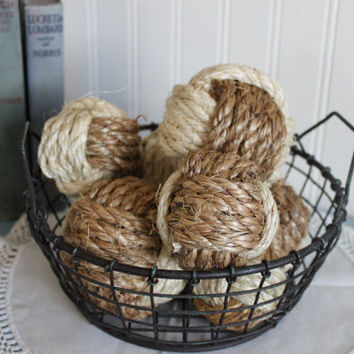 A bowlful of two-toned decorative rope balls/ monkey fists