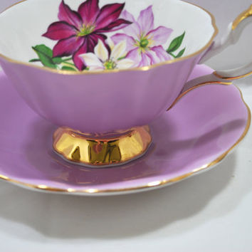 Footed Tea cup and Saucer in Porcelain Purple and Gold Queen Anne 1960