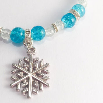 Frozen bracelet .. Icy clear and aqua blue crackle beads, sparkling rhinestone spacer beads and a snowflake charm