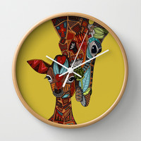 giraffe love ochre Wall Clock by Sharon Turner