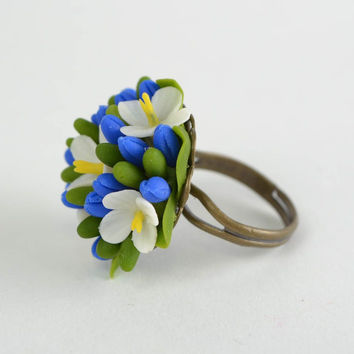 Handmade ring made of cold porcelain with flower and with adjustable size