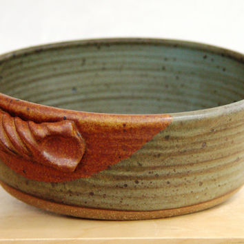 stoneware clay baking dish with rope handles. These come in sizes from individual to family size.