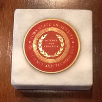 """Vintage collectible souvenir marble paperweight from Iowa State University (ISU) of Science and Technology. """"Science with Practice""""."""