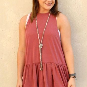 All Ruffled Up - Sleeveless Peplum Modal Top in Brick