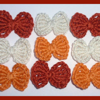 9 small rust, orange and cream crochet bows, appliques and embellishments