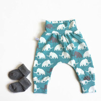 Baby harem pants with mammoths in gray and white. Pants with same fabric waistband and cuffs. Comfortable toddler pants. Jersey knit fabric.