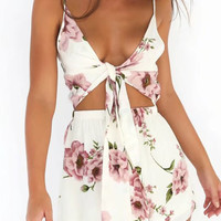 Polychrome V-neck Floral Tie Front Open Belly Romper Playsuit