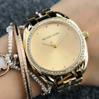 MK Micheal Kors  A minimalist 12 - diamond pointer to a woman's watch