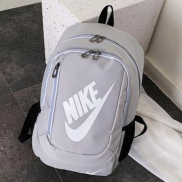 NIKE Sells Fashion Men and Women's Large Backpacks and Shoulder Bags Gray