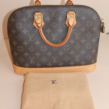Louis Vuitton Alma Bag pre-owned,authentic with dustbag,lock and keys
