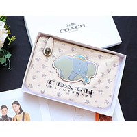 COACH 2019 new women's simple and versatile storage bag clutch bag