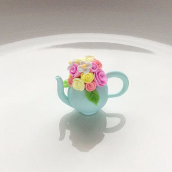 Miniature pale blue teapot with pink and yellow roses for 1/12 scale dollhouse handmade from polymer clay