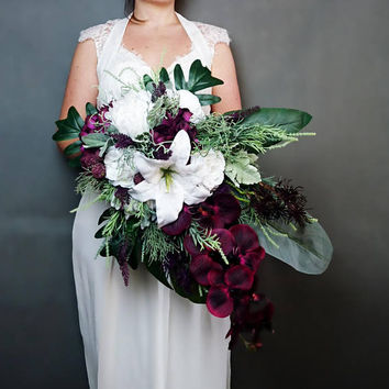 Plum purple white tropical flowers wedding bridal bouquet cascade greenery orchid lily rose monstera banana leaf grasses big long original