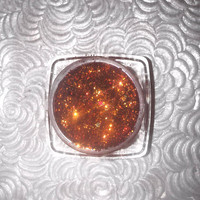 Shade name ( Henna Fire ). Rusty, red-orange loose glitter pigment.  4 grams of product in a jar with sifter and seal.