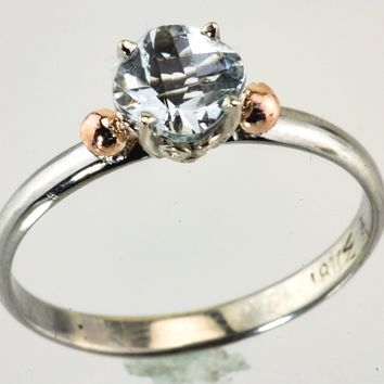 Aquamarine 18kt white and rose gold ring.